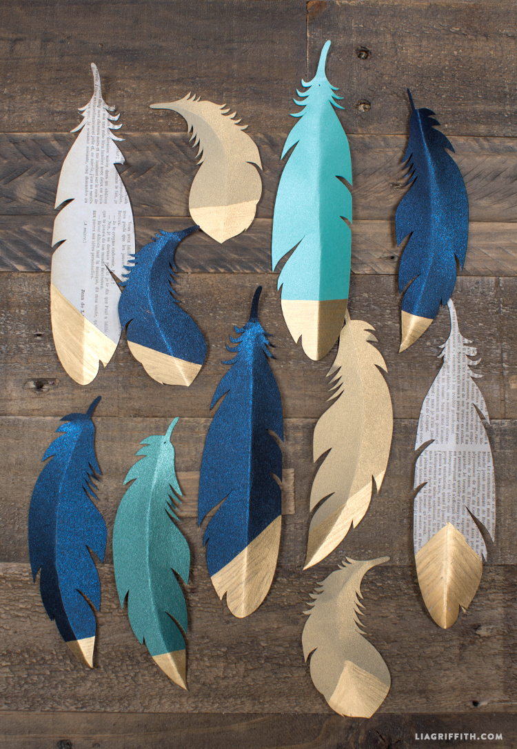 gold tipped paper feathers diy wedding decorations